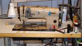 Heavy duty industrial Pfaff sewing machine in great working condition. Servo motor, compound walking foot, reverse. VERY heavy.