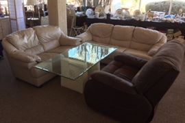 Leather Sofa and love seat. Plaster, wood and glass coffee table.