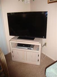 "40"" Sony TV on Media Cabinet"