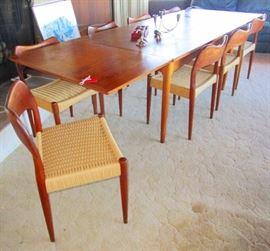Mid Century Teak extending table--with 8 teak chairs.