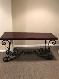 Beautiful wooden top sofa table Wrought iron legs and base  Brand new condition  Dimensions:  Width: 60 inches  Depth: 17 inches Height: 28inches