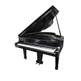 "Black Yamaha Grand Piano and Bench: A black Yamaha grand piano, serial number B 2163920 and marked ""Yamaha Piano, Nippon Gakki, Hamamatsi, Japan"". A matching black tufted bench is included."