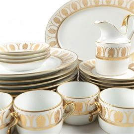 "Richard Ginori ""Pompei Gold"" Tableware: A set of Richard Ginori Pompei Gold tableware. This tableware from Richard Ginori is presented in the Pompei Gold pattern with gold acanthus leaves design on white. Included in this set is seven dinner plates, eight side plates, four teacups, four saucers, one creamer and one platter. The base is marked to the underside ""Richard Ginori Manifattura Di Diccia Florance Italy."""