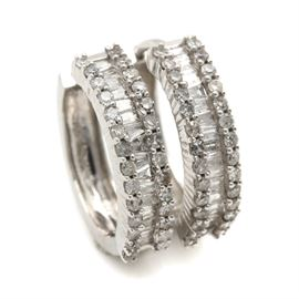 14K White Gold 1.22 CTW Diamond Huggie Hoop Earrings: A pair of 14K white gold 1.22 ctw diamond huggie hoop earrings featuring baguette diamonds set between rows of single cut diamonds.