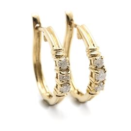 14K Yellow Gold Diamond Hoop Earrings: A pair of 14K yellow gold diamond hoop earrings.
