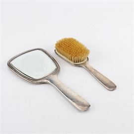 "Hand Hammered Sterling Silver Vanity Set: A hand hammered sterling silver vanity set. This includes a hand mirror with a beveled mirror and a hair brush. The pieces have simple handles with personalized engravings on the back. Each is marked with the makers mark and ""Hand Hammered."""