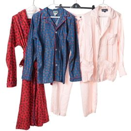 Men's Sleepwear Including Ralph Lauren and Tom & Jerry: A collection of men's sleepwear. This lot features a pink silk pajama set from Ralph Lauren that includes a pair of drawstring pants and a matching button-down top with embroidered monogram to the chest pocket. Also included is a blue polyester button-down shirt and red robe from Tom & Jerry, both with a repeating paisley pattern. All pieces are labeled to the interior.