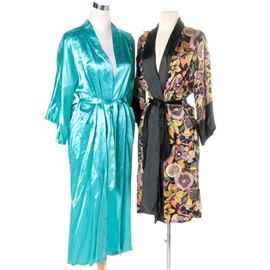 Vintage Kimono Style Robes: A pair of vintage Kimono style robes. The pair includes a long teal-blue silk robe with embroidered florals and dragons by Health. A shorter with robe featuring tropical style florals in muted purple, yellow and white hues with green and orange highlights completes the listing.