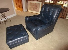 WOW. A navy blue leather chair and matching ottoman.