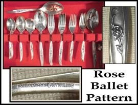 32 pieces of International Sterling flatware including two 8.5 inch slotted serving spoons. Rose Ballet pattern.