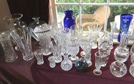A collection of  large vases, bud vases, and rose bowls