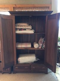 Interior of armoire; hooks, removable shelves, 2 drawers - solid piece in excellent condition