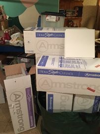 Nine full boxes of Armstrong Ceiling tiles - each box has 40 one square foot tiles
