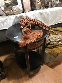 end table and many curtains and tassels