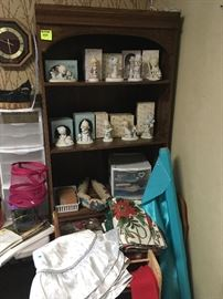 bookshelf and collectible Precious Moments figurines, Christmas table linens and tree skirts, quilt racks