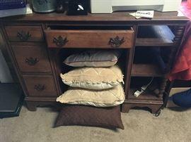 wooden desk, decorative pillows
