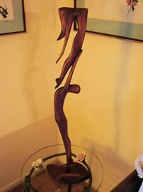 One of several carved Brazilian mahogany figurines