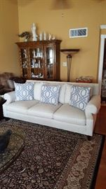 Large Oriental rug, sofa and china cabinet