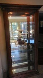 "Dining Room:  A lighted display cabinet has four adjustable glass shelves, one lower stationery mirrored shelf and a mirror back.  The doors on each side open so you can easily add your own treasures.  It measures 42"" wide x 17"" deep x 81"" tall."
