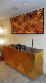 "Dining Room:  We had this gorgeous custom made sideboard brought back upstairs from the lower level (closer photos coming up).  It fits perfectly under the abstract art by artist D. BRYNE which measures 32"" tall x 74"" wide."