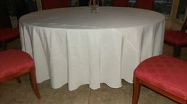 Dining Room:  The round table is now shown with one of the large tablecloths for sale.  Available colors are  cream, taupe and purple.
