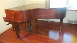 "Living Room:  This is a beautiful mahogany STEINWAY baby grand piano (bench included).  It is a Model M, dated 1926, and measures 5' 7"" from keyboard to tail. It was fully refurbished 20 years ago.   More photos follow."