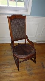 Antique cane rocker seat needs repair or replacement.