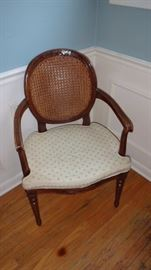 Vintage cane side chair, seat under pad needs replacement.