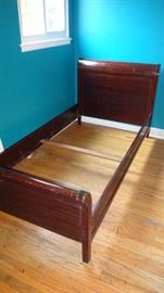 Vintage single (twin) sleigh bed.  Complete with side raids and center board.