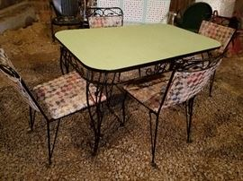 green formica and black wrought iron table and 4 chairs