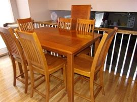 Stunning table top Mission style counter/pub height table with 2 leave and 6 chairs