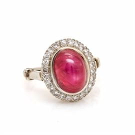 14K White Gold 8.04 CT Star Ruby and Diamond Arthritic Ring: A 14K white gold star ruby and diamond ring. This ring features an untreated star ruby within a diamond halo. This centerpiece rests on an arthritic shank that unhinges to allow comfortable placement.