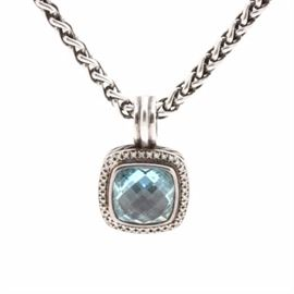 David Yurman Sterling Silver Blue Topaz and Diamond Necklace: A David Yurman sterling silver blue topaz and diamond necklace. This necklace features an enhancer pendant containing a large square cushion cabochon of blue topaz surrounded by a halo of diamonds with an openwork back that is affixed to a fancy foxtail chain.
