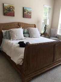 King size sleigh bed with new mattress $350.00. Linens $50 for all on bed.