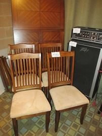Beautiful dining table and chairs with Peavey amplifier and power modulator