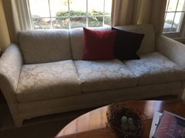 White custom designed white sofa and love seat.  Very Very clean.
