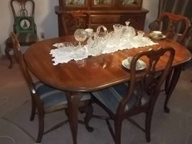 excellent condition dining table, two captains chairs, 4 side chairs, two leaves and matching china cabinet