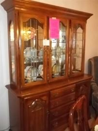 excellent condition lighted china cabinet with antiqued glass