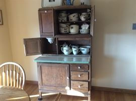 Beautiful Hoosier cabinet in great condition and full of silhouette china