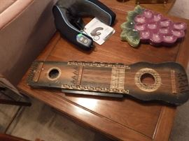 Dulcimer I think and most opinions agree but one said auto harp hmmm