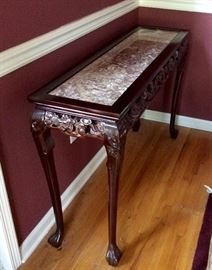 Carved side table with marble top