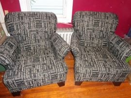 Pair of upholstered wing chairs in Latin phrases fabric