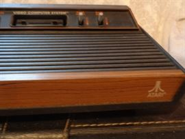Vintage Atari system with many games in carrying cases