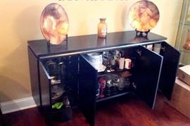 Modern server/sideboard by GFI Firenze in black shown open.
