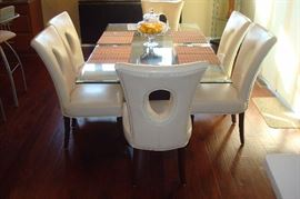 Modern glass top pedestal table and six chairs by Home Elegance.