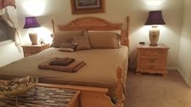King size bed with two nightstands and dresser with mirror
