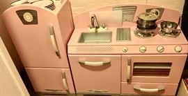 Retro pink play kitchen.  Food, dishes & itensils to go with