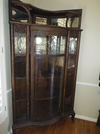 Stunning curved front antique display cabinet