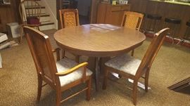 $75  formica top table with four chairs and 2 leaves