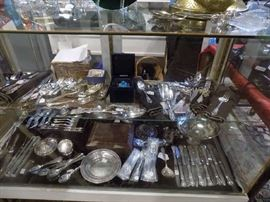 Sterling flatware: La Reine, Crown Baroque, other. Mother of pearl handled knives and fruit sets. Sterling salts, salt spoons, and small dishes.